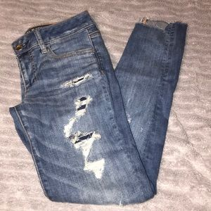 Cute ripped American Eagle Super-Low Jeggings.